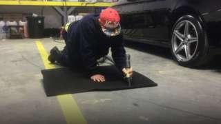 Michael doing work in garage