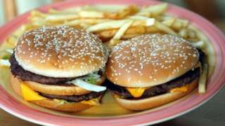 Two burgers and fries
