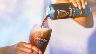 A can of Guinness being poured