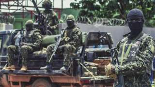 Special forces secure a road near Guinea's presidential palace on Monday