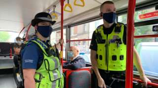 Police officers on a bus
