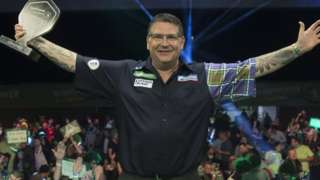 Gary Anderson with the Champions League of Darts trophy