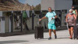 British tourists arrive at the Tenerife Sur Reina Sofia airport on the Canary Island of Tenerife on Tuesday
