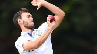 Derbyshire bowler Alex Hughes