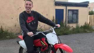 James Ferguson posing on a bike