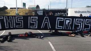 Protesters lying on a road en route to Heathrow