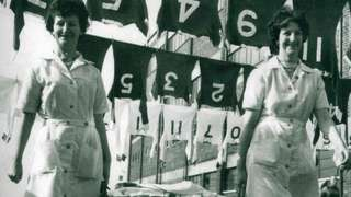Ken Ramsden's mum and aunty hanging shirts outside Old Trafford