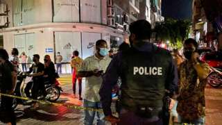 Police secure a site after a suspected bomb blast injured former Maldives president