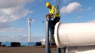 worker unloading wind power parts