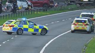 Police cars and wreckage on the A1 (M) following the crash