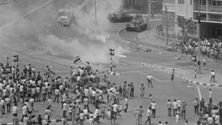 Violence Continues in Thailand. Bangkok, Thailand: Demonstrating students hold their ground after hurling tear gas canisters back at Army tanks trying to disperse the crowd October 14. Anti-government riots have left 400 persons dead and toppled the ten-year-old military regime of Field Marshall Thanom Kittikachorn. Thanom resigned his post as Prime Minister October 14 and on October 15 Radio Thailand said he had left the country.
