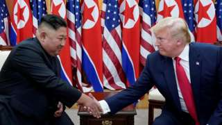 US President Donald Trump shakes hands with North Korean leader Kim Jong-un at the demilitarized zone separating the two Koreas