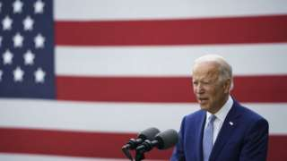 Joe Biden speaks during a campaign event at the Mountain Top Inn and Resort on 27 October in Warm Springs, Georgia