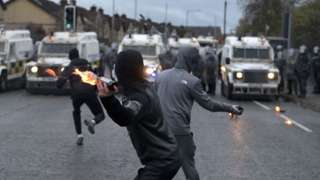 Youths with petrol bombs