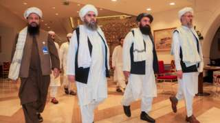 File photo showing Taliban negotiators arriving at Afghan peace talks in Doha, Qatar (12 August 2021)