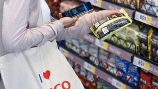 Shopper at experimental Tesco store