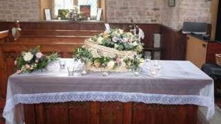 Ada's casket