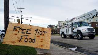 A handmade sign offering free hot food is seen in front of the Royal Tandoor restaurant after Hurricane Laura passed through the area in Lake Charles, Louisiana,