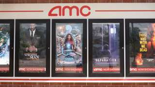 Movie posters outside of an AMC cinema