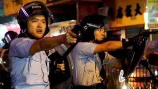 Police pointing guns