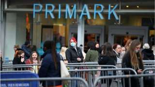 Shoppers queuing outside the Primark in Stoke on Trent