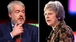 Carwyn Jones and Theresa May in separate file photos