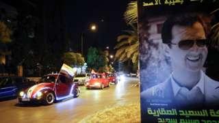 د بشار اسد ملاتړي د نوموړي بری لمانځي