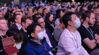 Attendees at the Samsung event in San Francisco wear surgical face masks
