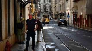 Man wearing mask in Lisbon