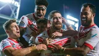 St Helens celebrate Kyle Amor (centre) scoring against Hull KR