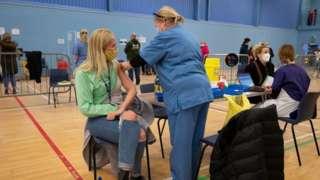 People receive their coronavirus vaccine