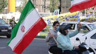 Scooter rally in Tehran with Iranian flags