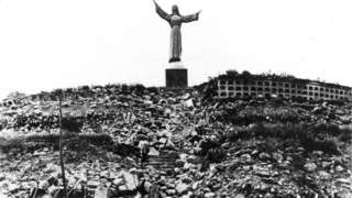 Statue of Christ at Cemetery Hill overlooking Yungay, which together with 4 palm trees, is all that remained of the city.