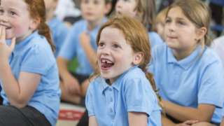Stock image of young pupils paying attention in class