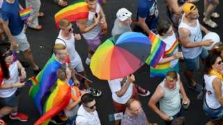 People march with their rainbow colors from the parliament building in Budapest downtown during the lesbian, gay, bisexual and transgender (LGBT) Pride Parade in the Hungarian capital