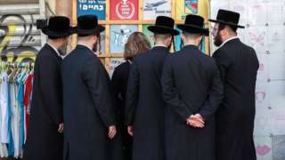 Ultra-Orthodox Jewsat a market in Jerusalem in December 2019