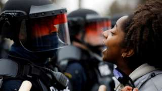 A demonstrator confronts police during a protest after Daunte Wright, was shot in Brooklyn Center, Minnesota, US