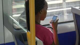 Girl wey dey press phone inside bus