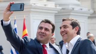 Macedonian Prime Minister Zoran Zaev (L) makes a selfie with his Greek counterpart Alexis Tsipras prior to their meeting in Skopje on April 2, 2019.