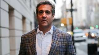 US President Donald Trump's personal lawyer Michael Cohen exits a hotel in New York City.