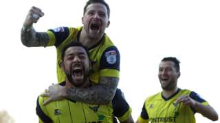 Oxford's Kane Hemmings celebrates his goal against Newcastle