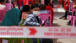 People wait to get tested inside a red zone with strict lockdown measures during the latest outbreak of the coronavirus disease (COVID-19) in Phnom Penh, Cambodia