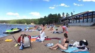 Bathers on the shore of Lake Storsjön in Sweden