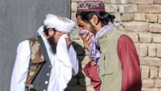 Worshippers react at the scene of an attack that targeted a mosque in the outskirt of Kabul, Afghanistan, 14 May 2021.
