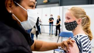 Girl receiving Covid vaccination in the Netherlands in July 2021