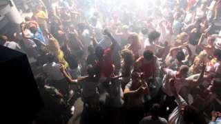 Clubbers on dancefloor