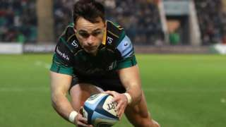 Northampton winger Tom Collins scores a try