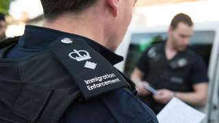 Immigration enforcement officers raid a home in Southall in 2015