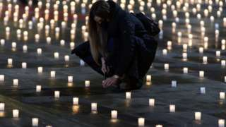 Activists lit almost 5000 candles to commemorate the people who died with coronavirus in Switzerland, on the Bundesplatz, front of the Federal Palace, in Bern, Switzerland, 06 December 2020