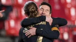 Lionel Messi and Antoine Griezmann celebrate